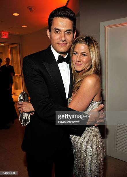 WEST HOLLYWOOD CA FEBRUARY 22 Musician John Mayer and actress Jennifer Aniston attends the 2009 Vanity Fair Oscar party hosted by Graydon Carter at...