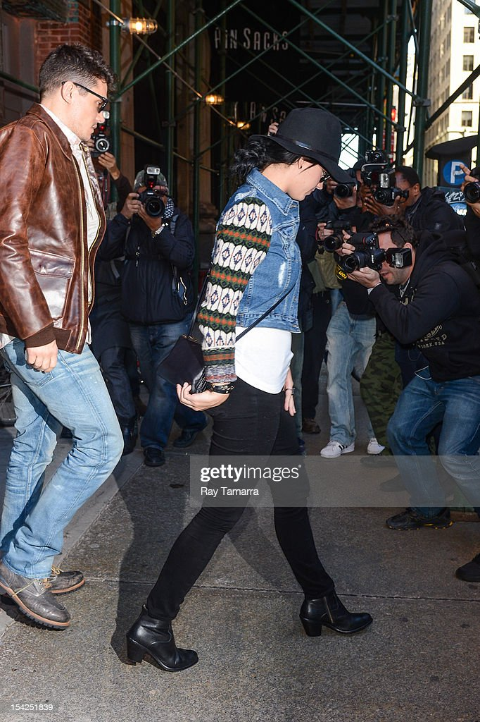 Musician John Mayer (L) and singer Katy Perry leave ABC Kitchen on October 16, 2012 in New York City.