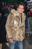 Musician John Mayer leaves the 'Good Morning America' taping at the ABC Times Square Studios on December 17 2013 in New York City