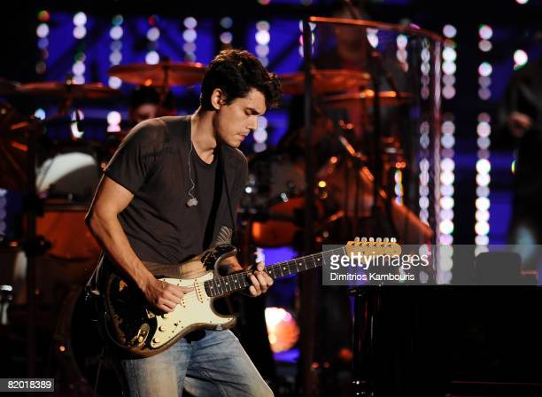 Musician John Mayer performs with Billy Joel during the 'Last Day at Shea' at Shea Stadium on July 16 2008 in New York City