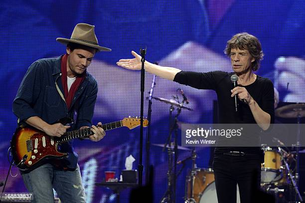 Musician John Mayer performs with musician Mick Jagger of The Rolling Stones onstage during the Rolling Stones '50 Counting' tour at Honda Center on...