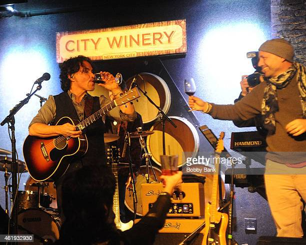 Musician John Oates and CEO of City Winery Michael Dorf celebrates City Winery's one millionth wine glass at City Winery An Acoustic Evening With...