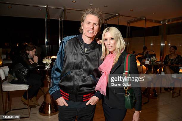 Musician John Taylor of Duran Duran and fashion designer Gela Nash attend Warner Music Groups' annual Grammy celebration at Milk Studios Los Angeles...