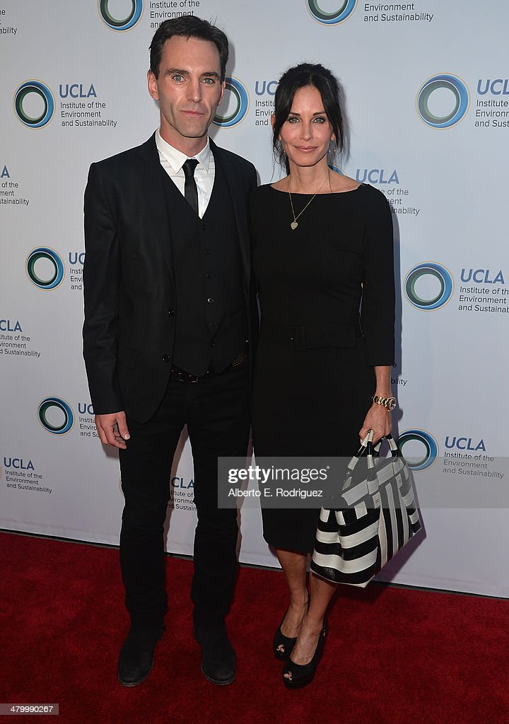 Musician Johnny McDaid and actress <a gi-track='captionPersonalityLinkClicked' href=/galleries/search?phrase=Courteney+Cox&family=editorial&specificpeople=203101 ng-click='$event.stopPropagation()'>Courteney Cox</a> attend An Evening of Environmental Excellence presented by the UCLA Institute of the Environment and Sustainability on March 21, 2014 in Beverly Hills, California.
