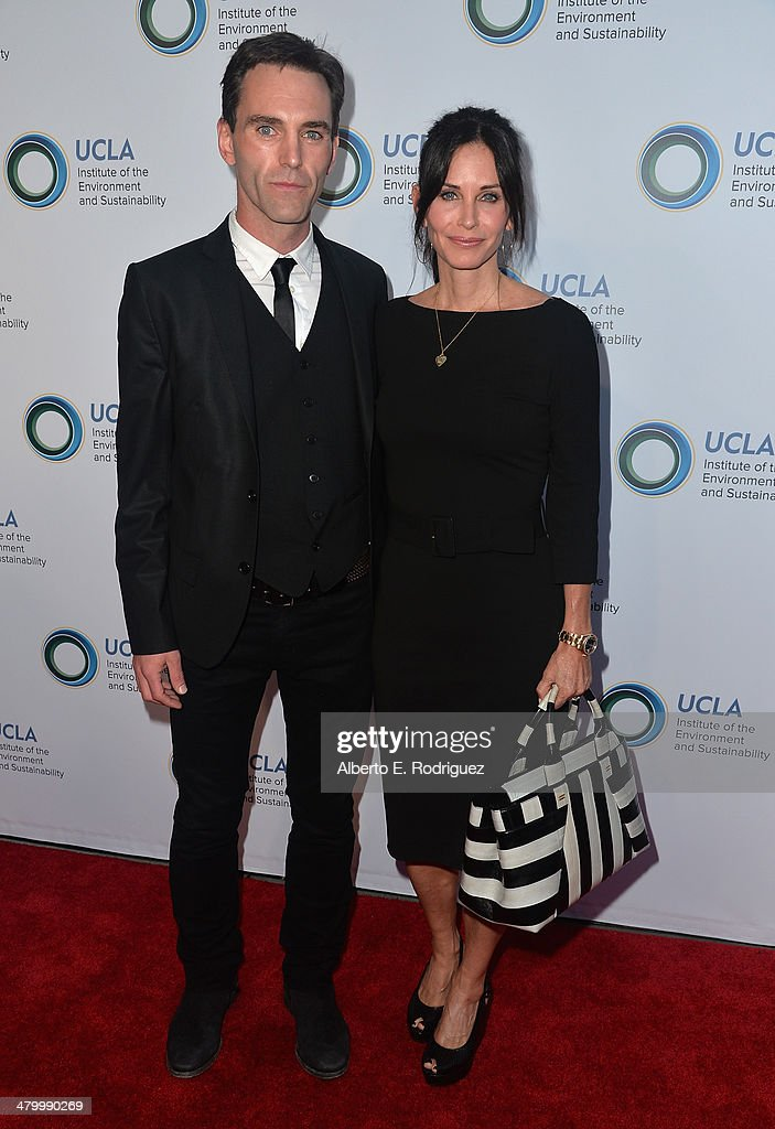 Musician Johnny McDaid and actress Courteney Cox attend An Evening of Environmental Excellence presented by the UCLA Institute of the Environment and Sustainability on March 21, 2014 in Beverly Hills, California.