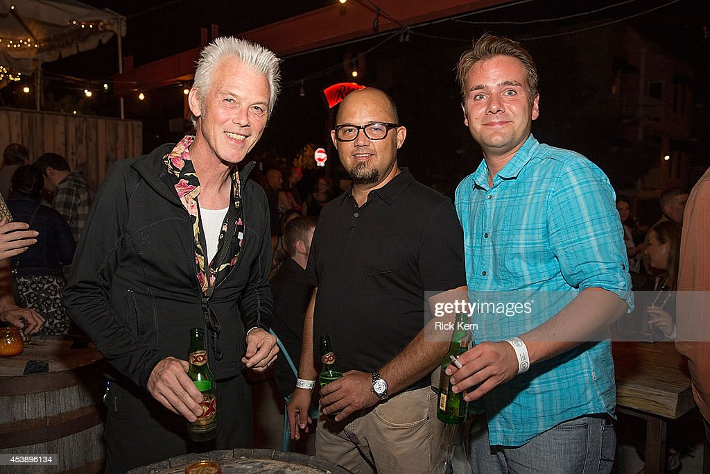 Musician Johnny Reno (L) and guests pose during the 'Sin City: A Dame to Kill For' premiere after party at The Rattle Inn on August 20, 2014 in Austin, Texas.