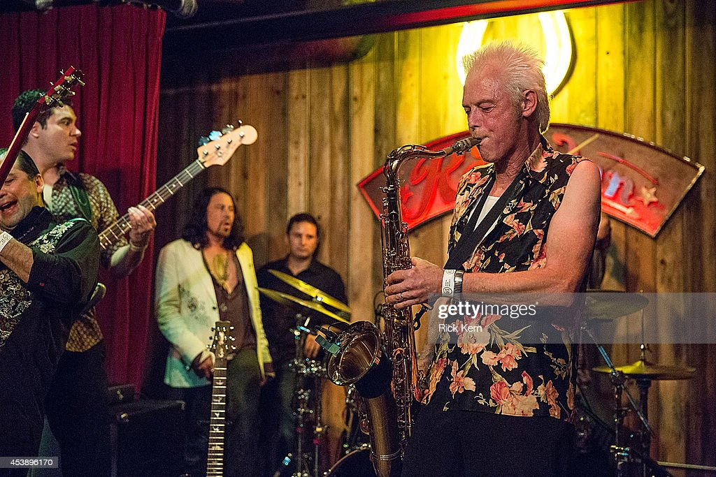 Musician Johnny Reno (R) performs on stage with Chingon during the 'Sin City: A Dame to Kill For' premiere after party at The Rattle Inn on August 20, 2014 in Austin, Texas.