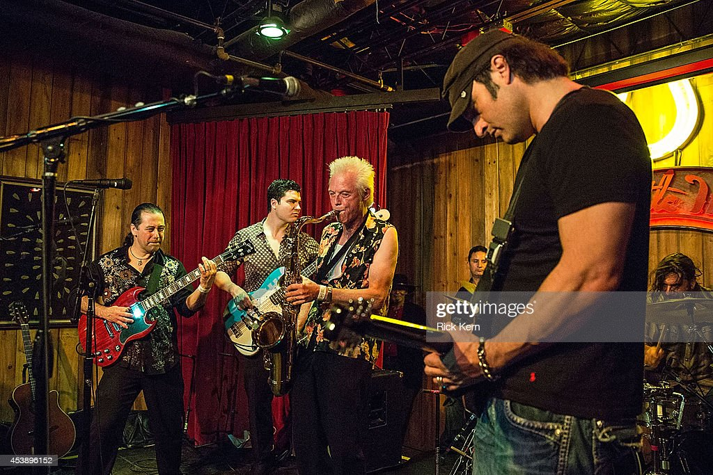 Musician Johnny Reno performs on stage with director/musician Robert Rodriguez and his band Chingon during the 'Sin City: A Dame to Kill For' premiere after party at The Rattle Inn on August 20, 2014 in Austin, Texas.
