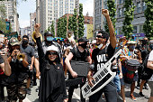 Jon Batiste and Musicians Join Protest In Support Of...