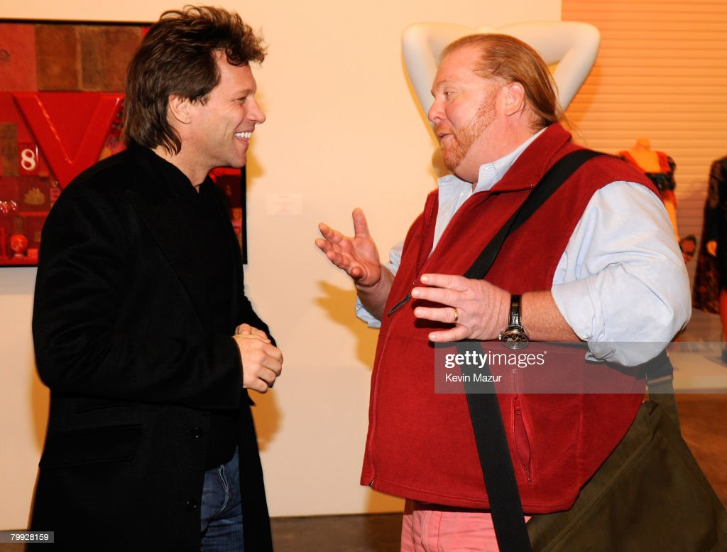 red cocktail party photos and images getty images musician jon bon jovi and chef mario batali attend the red auction to benefit