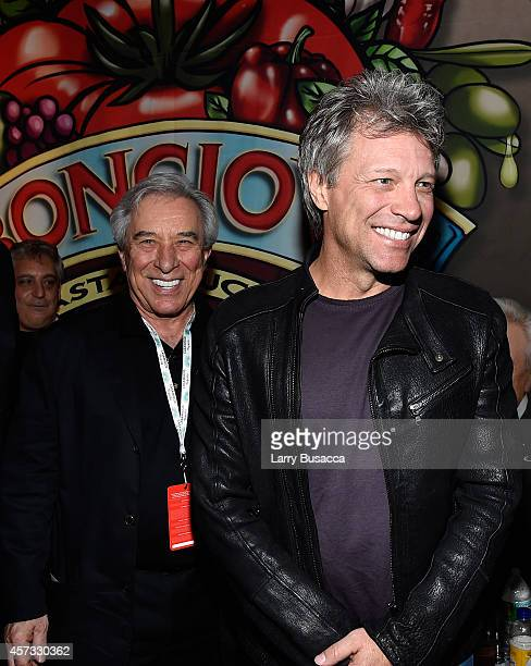 Musician Jon Bon Jovi and father John Francis Bongiovi Sr pose at the Bongiovi Brand chef station at Ronzoni's La Sagra Slices hosted by Bongiovi...