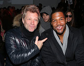 Musician Jon Bon Jovi and Michael Strahan attend the Kenneth Cole Collection presentation during MercedesBenz Fashion Week Fall 2014 at The Garage at...