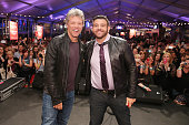 Musician Jon Bon Jovi and TV personality Adam Richman pose on stage at Ronzoni's La Sagra Slices hosted by Bongiovi Brand pasta sauces Adam Richman...