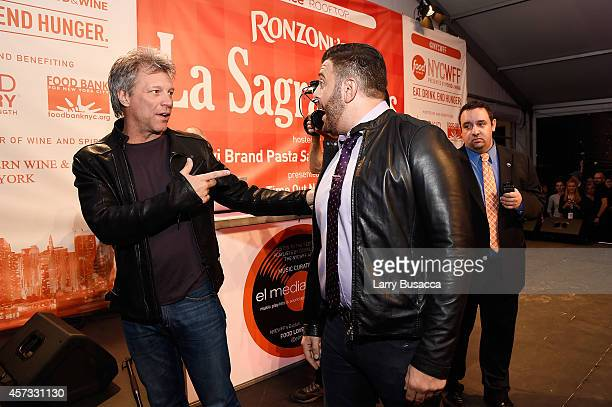 Musician Jon Bon Jovi and TV personality Adam Richman speak at Ronzoni's La Sagra Slices hosted by Bongiovi Brand pasta sauces Adam Richman presented...