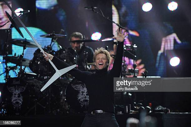 Musician Jon Bon Jovi performs at '121212' a concert benefiting The Robin Hood Relief Fund to aid the victims of Hurricane Sandy presented by Clear...