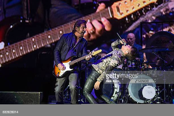 Musician Jonathan Cain musician/vocalist Arnel Pineda and drummer Steve Smith of Journey perform in cocert at Austin360 Amphitheater on May 18 2016...