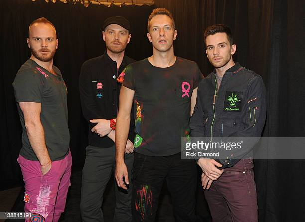 Musician Jonny Buckland Will Champion Chris Martin and Guy Berryman of the band Coldplay attend The 54th Annual GRAMMY Awards at Staples Center on...