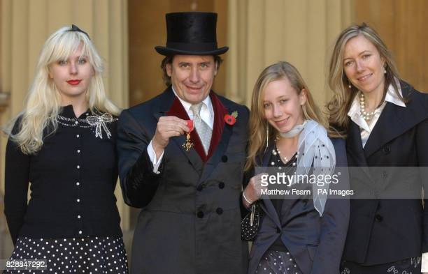 Musician Jools Holland with his daughters Rosie and Mabel and wife Christobel at Buckingham Palace after being awarded with an an OBE by Britain's...