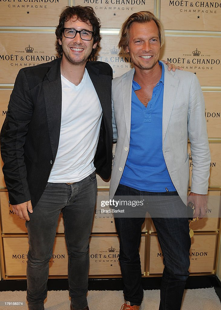 Musician Josh Groban(L) and U.S. vice president of Champagne maker Moet & Chandon Ludovic du Plessis attend the Moet & Chandon Suite at USTA Billie Jean King National Tennis Center on August 31, 2013 in New York City.