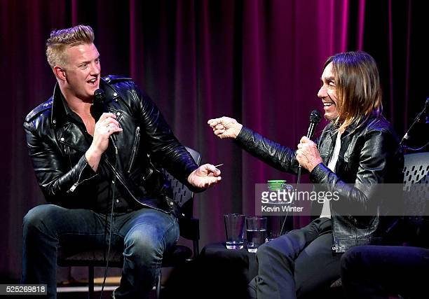 Musician Josh Homme and singer Iggy Pop speak onstage at the Grammy Museum on April 27 2016 in Los Angeles California