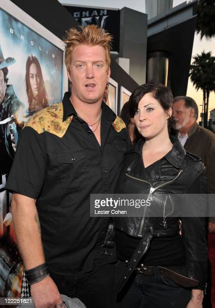 Musician Josh Homme of Queens of the Stone Age and wife musician Brody Dalle of The Distillers attend the 'Jonah Hex' Los Angeles premiere held at...