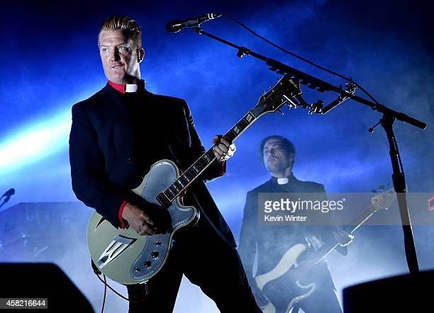 Musician Josh Homme of Queens of The Stone Age performs at the Forum on October 31 2014 in Inglewood California