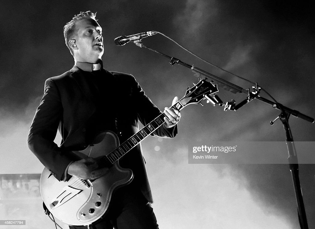 Musician Josh Homme of Queens of the Stone Age performs at the Forum on October 31, 2014 in Inglewood, California.