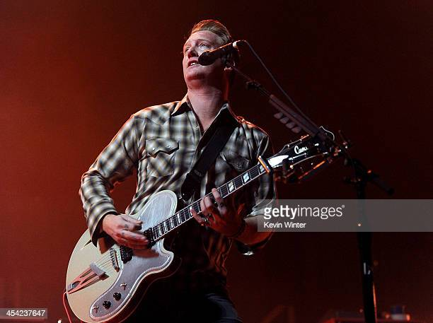 Musician Josh Homme of Queens of the Stone Age performs onstage during The 24th Annual KROQ Almost Acoustic Christmas at The Shrine Auditorium on...
