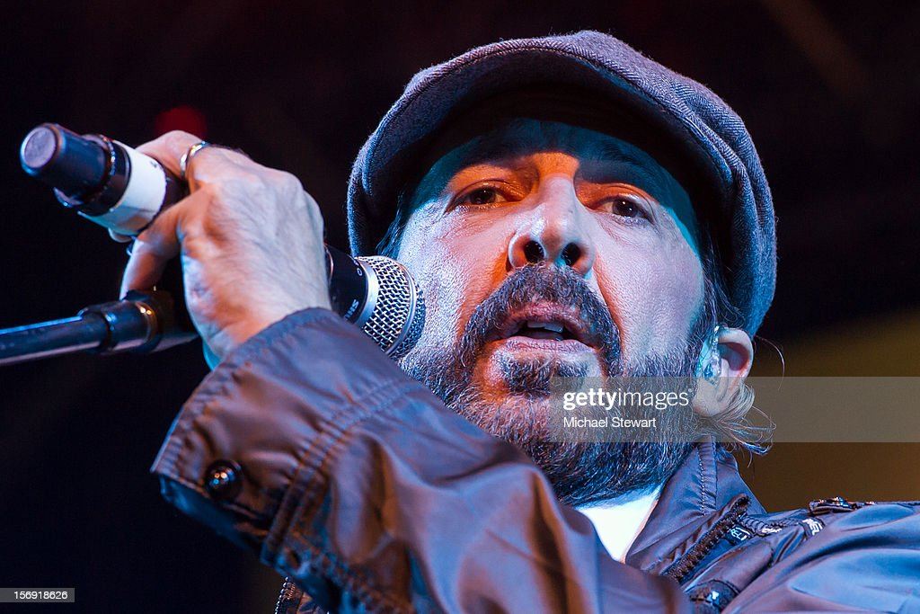 Musician <a gi-track='captionPersonalityLinkClicked' href=/galleries/search?phrase=Juan+Luis+Guerra&family=editorial&specificpeople=208921 ng-click='$event.stopPropagation()'>Juan Luis Guerra</a> performs during the Hurricane Sandy Benefit concert at the Barclays Center on November 24, 2012 in the Brooklyn borough of New York City.