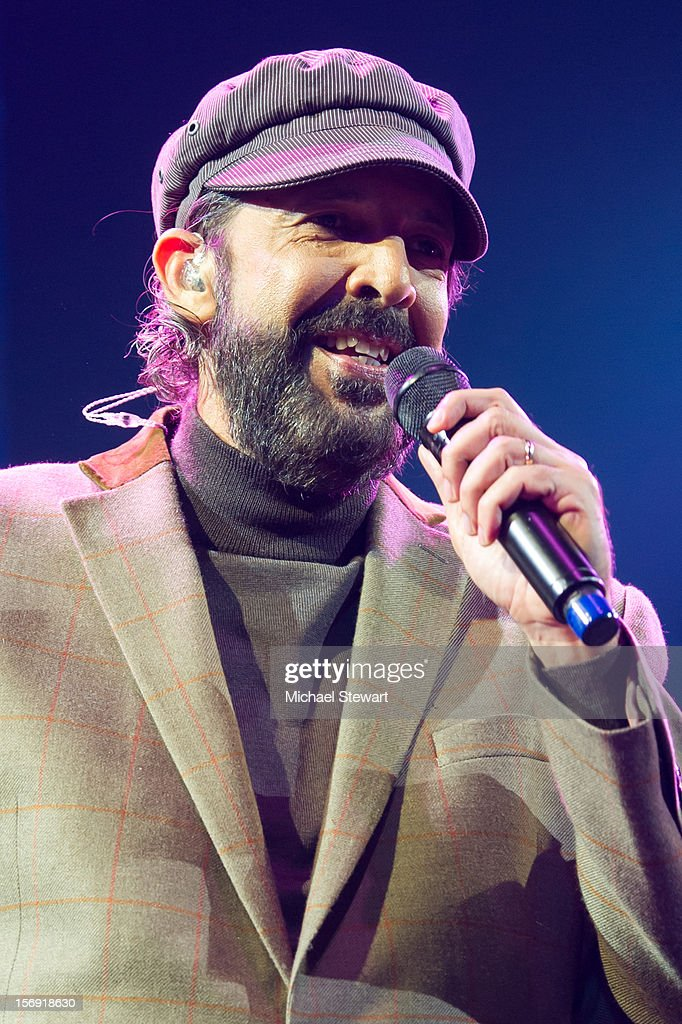 Musician Juan Luis Guerra performs during the Hurricane Sandy Benefit concert at the Barclays Center on November 24, 2012 in the Brooklyn borough of New York City.