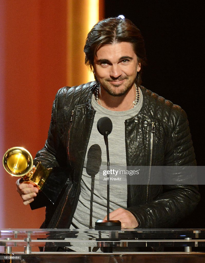 Musician <a gi-track='captionPersonalityLinkClicked' href=/galleries/search?phrase=Juanes&family=editorial&specificpeople=202467 ng-click='$event.stopPropagation()'>Juanes</a> accepts an award onstage during the 55th Annual GRAMMY Awards at Nokia Theatre on February 10, 2013 in Los Angeles, California.