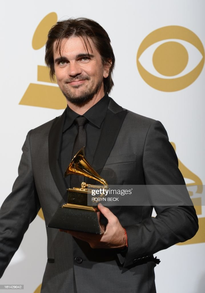 Musician Juanes poses with his trophy for best Latin Pop album in the press room at the Staples Center during the 55th Grammy Awards in Los Angeles, California, February 10, 2013. AFP PHOTO Robyn BECK