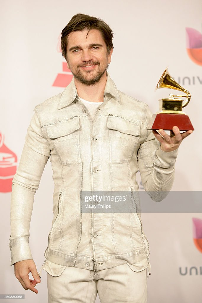 Musician <a gi-track='captionPersonalityLinkClicked' href=/galleries/search?phrase=Juanes&family=editorial&specificpeople=202467 ng-click='$event.stopPropagation()'>Juanes</a>, winner of Best Pop-Rock Album, poses in the press room during the 15th annual Latin GRAMMY Awards at the MGM Grand Garden Arena on November 20, 2014 in Las Vegas, Nevada.