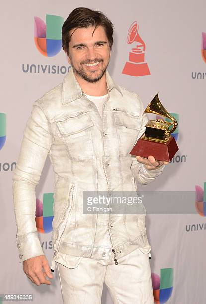Musician Juanes winner of Best PopRock Album poses in the press room during the 15th annual Latin GRAMMY Awards at the MGM Grand Garden Arena on...