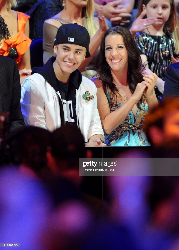 Musician Justin Bieber and mother Pattie Mallette attend the 2011 CMT Music Awards at the Bridgestone Arena on June 8 2011 in Nashville Tennessee