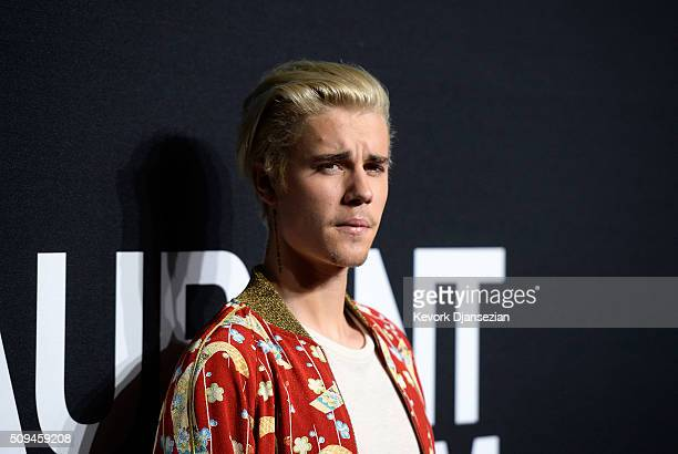 Musician Justin Bieber attends the Saint Laurent show at The Hollywood Palladium on February 10 2016 in Los Angeles California