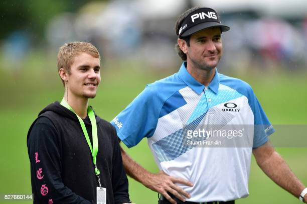 Musician Justin Bieber looks on with Bubba Watson of the United States during a practice round prior to the 2017 PGA Championship at Quail Hollow...