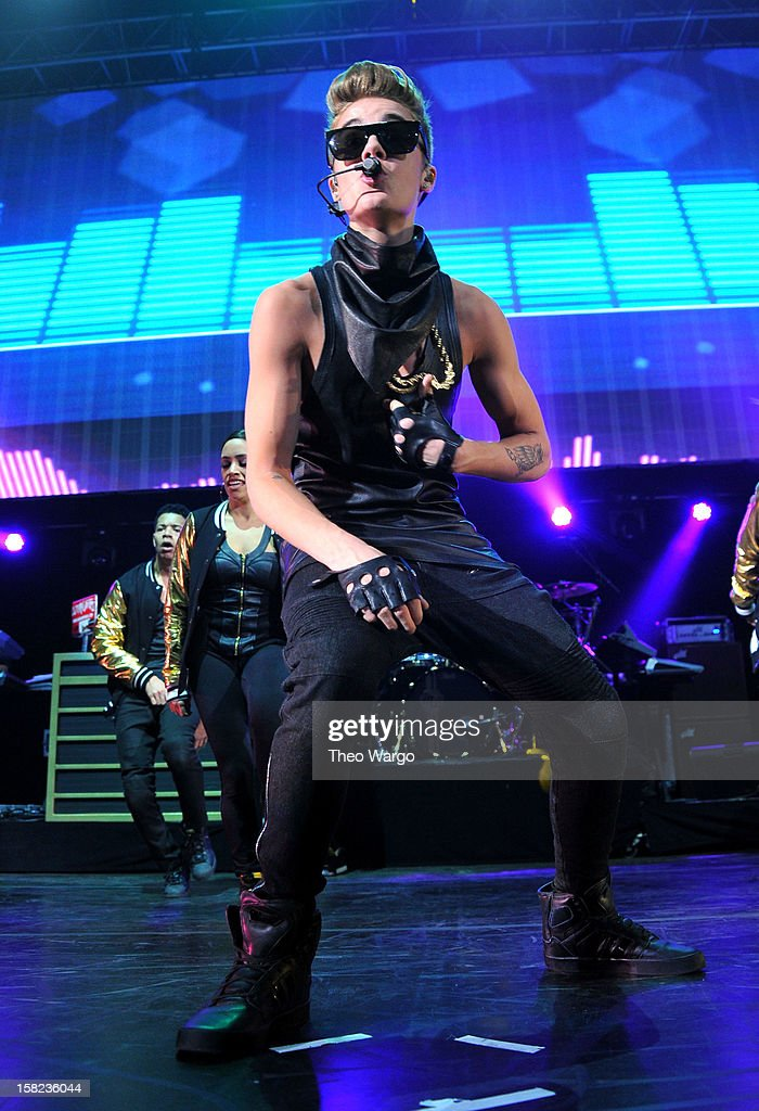 Musician <a gi-track='captionPersonalityLinkClicked' href=/galleries/search?phrase=Justin+Bieber&family=editorial&specificpeople=5780923 ng-click='$event.stopPropagation()'>Justin Bieber</a> performs onstage during Hot 99.5's Jingle Ball 2012, presented by Charleston Alexander Diamond Importers, at The Patriot Center on December 11, 2012 in Washington, D.C.