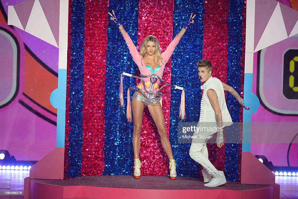 Musician <a gi-track='captionPersonalityLinkClicked' href=/galleries/search?phrase=Justin+Bieber&family=editorial&specificpeople=5780923 ng-click='$event.stopPropagation()'>Justin Bieber</a> (R) performs while model <a gi-track='captionPersonalityLinkClicked' href=/galleries/search?phrase=Jessica+Hart&family=editorial&specificpeople=4436555 ng-click='$event.stopPropagation()'>Jessica Hart</a> walks the runway during the 2012 Victoria's Secret Fashion Show at the Lexington Avenue Armory on November 7, 2012 in New York City.