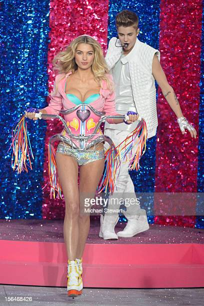 Musician Justin Bieber performs while model Jessica Hart walks the runway during the 2012 Victoria's Secret Fashion Show at the Lexington Avenue...