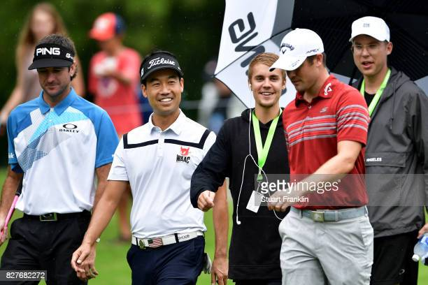 Musician Justin Bieber speaks to Wesley Bryan Bubba Watson and Kevin Na of the United States during a practice round prior to the 2017 PGA...