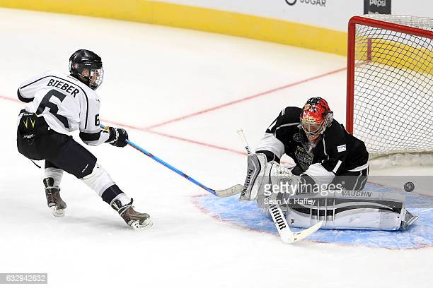 Musician Justin Bieber with the puck in front of the net during the 2017 NHL AllStar Celebrity Shootout as part of the 2017 NHL AllStar Weekend at...