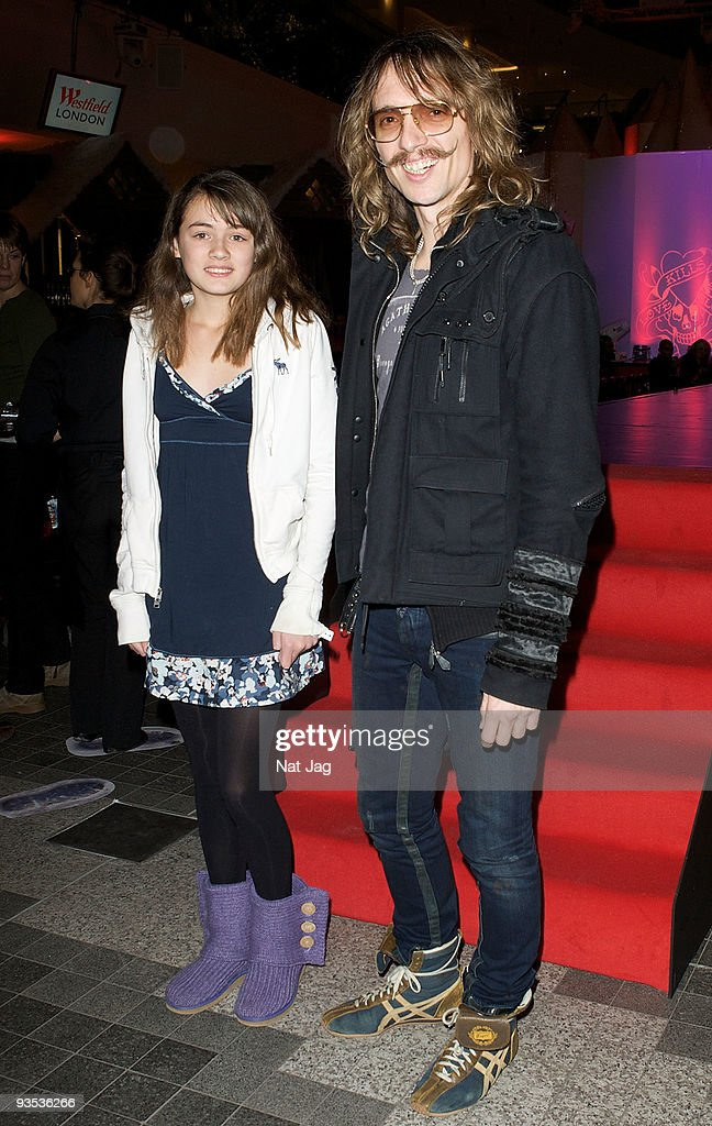 Musician <a gi-track='captionPersonalityLinkClicked' href=/galleries/search?phrase=Justin+Hawkins&family=editorial&specificpeople=171558 ng-click='$event.stopPropagation()'>Justin Hawkins</a> (R) and a guest attend the opening of the new Ed Hardy store at Westfield on December 1, 2009 in London, England.
