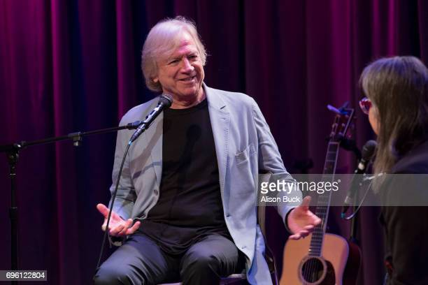 Musician Justin Hayward and Vice President of The GRAMMY Foundation and MusiCares Scott Goldman speak onstage during An Evening With Justin Hayward...