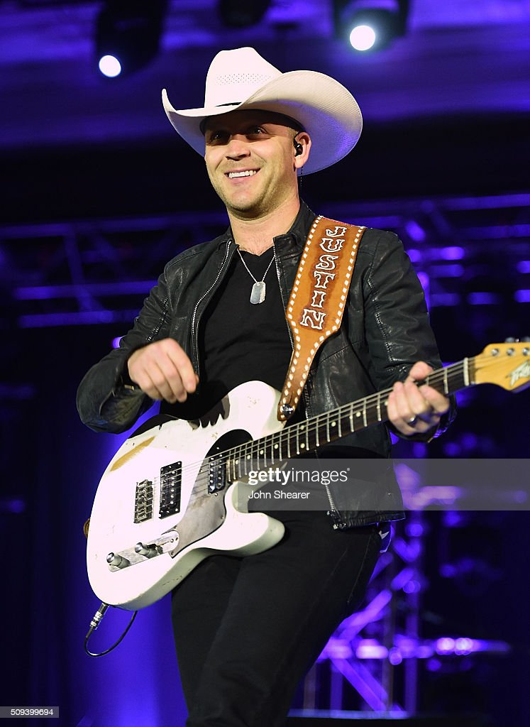 Musician <a gi-track='captionPersonalityLinkClicked' href=/galleries/search?phrase=Justin+Moore&family=editorial&specificpeople=2437772 ng-click='$event.stopPropagation()'>Justin Moore</a> performs during the CRS Big Machine Label Group lunch at Omni Hotel on February 10, 2016 in Nashville, Tennessee.
