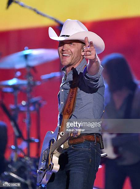 Musician Justin Moore performs onstage during the 2015 iHeartRadio Country Festival at The Frank Erwin Center on May 2 2015 in Austin Texas The 2015...