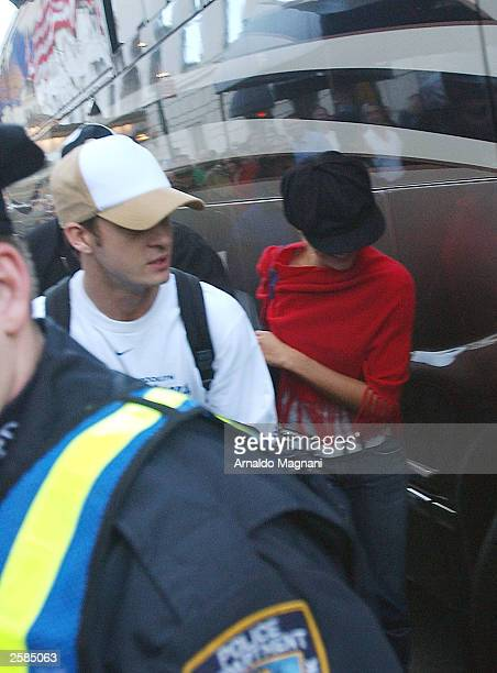 Musician Justin Timberlake and actress Cameron Diaz board Timberlake''s tour bus at a hotel October 12 2003 in New York City