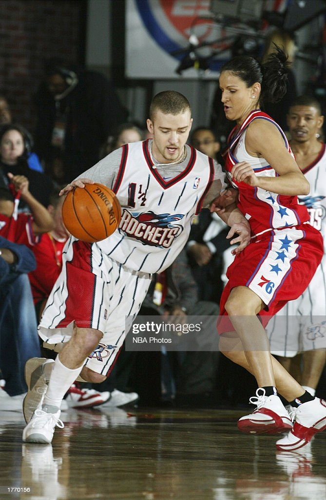 Musician Justin Timberlake drives to the basket in the Celebrity Game at NBA Jam Session during the 2003 NBA All Star Weekend at the Georgia World...