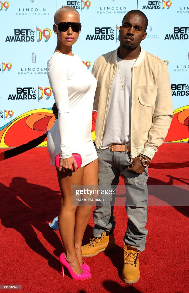 Musician <a gi-track='captionPersonalityLinkClicked' href=/galleries/search?phrase=Kanye+West+-+Musician&family=editorial&specificpeople=201803 ng-click='$event.stopPropagation()'>Kanye West</a> and <a gi-track='captionPersonalityLinkClicked' href=/galleries/search?phrase=Amber+Rose+-+Model&family=editorial&specificpeople=2025513 ng-click='$event.stopPropagation()'>Amber Rose</a> arrive at the 2009 BET Awards held at the Shrine Auditorium on June 28, 2009 in Los Angeles, California.