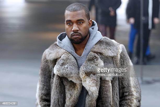 US musician Kanye West arrives to attend Givenchy's Fall/Winter 20142015 men's fashion show in Paris on January 17 2014 AFP PHOTO FRANCOIS GUILLOT